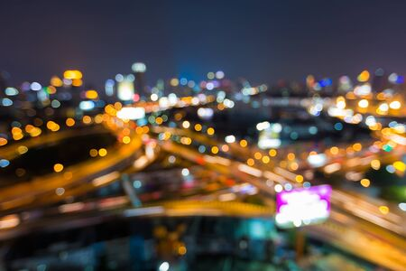 Aerial view twilight, city road interchanged, abstract blurred lights background