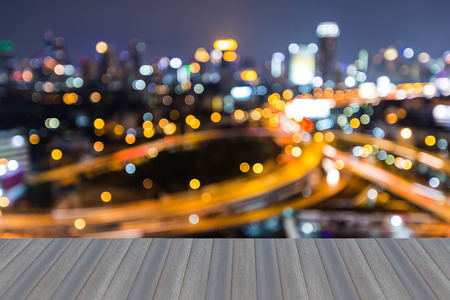 interchanged: Opening wooden floor, abstract blurred highway interchanged with city downtown background