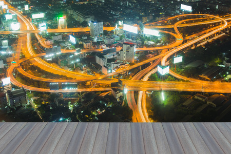 Opening wooden floor, aerial view Bangkok highway interchanged night view, Thailand Stock Photo
