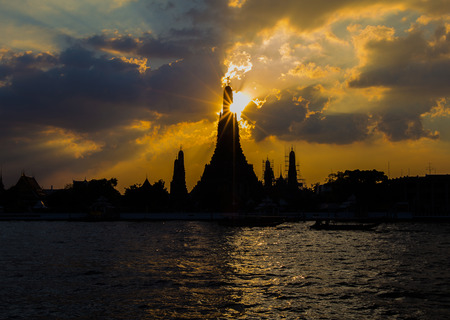 Silhouette of Wat Arun Temple along with Chaopraya River, Bangkok Thailand Landmark Stock Photo