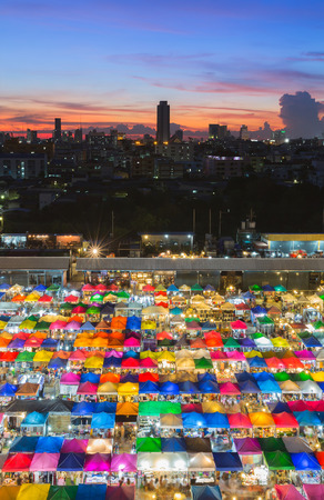 Multiple colours nights market with city sunset sky background