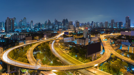 interchanged: Aerial view highway interchanged with city downtown background at twilight