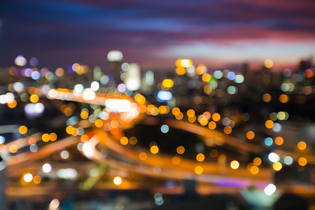Night blurred lights city background and road interchanged, abstract background