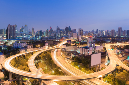 Highway interchanged with city downtown background, Bangkok Thailand