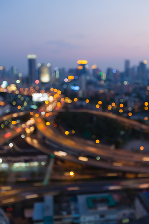 interchanged: Blurred bokeh lights city and highway interchanged, abstract background