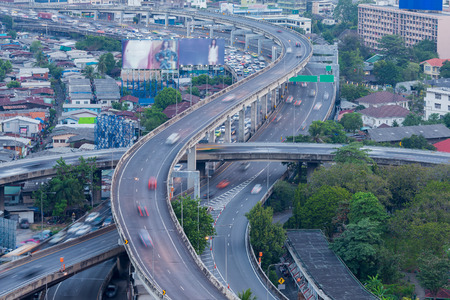 interchanged: Moving car on highway interchanged, cityscape background