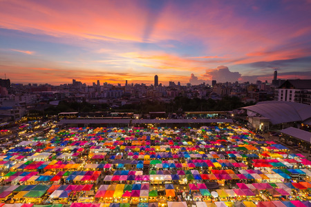 Aerial view, multiple colours night market rooftop with dramatic after sunset sky background