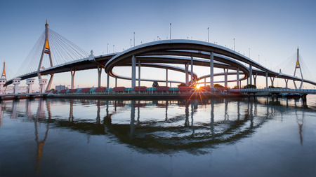 bridged: Sunset over two suspension bridged with reflection and clear blue sky background