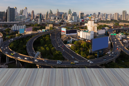 Opening wooden floor, Bangkok city downtown with highway interchanged, Thailand
