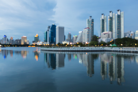 Bangkok office building and tower with reflection at twilights, Thailand Stock Photo
