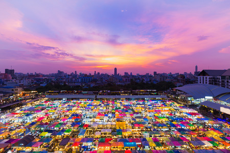 Aerial view night market roof top with dramatic sky and city downtown background