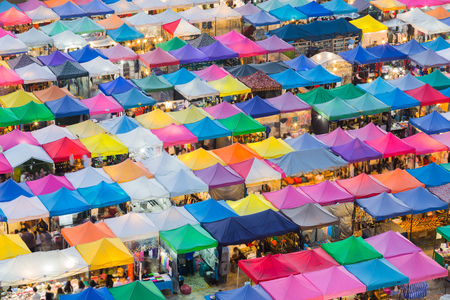 Top view, multiple colour night market roof in Bangkok city Thailand Stock Photo