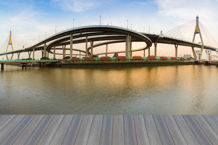 bridged: Opening wooden floor, panorama twin suspension bridged connect to highway interchanged river front, Bangkok Thailand