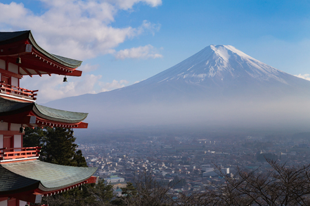 sengen: Fuji volcano mountain behind red pagoda aerial view city downtown, Japan Stock Photo