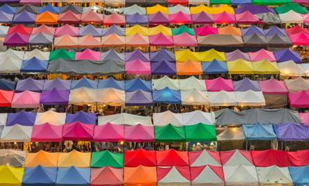 Multiple colours weekend market rooftop, aerial view cityscape background