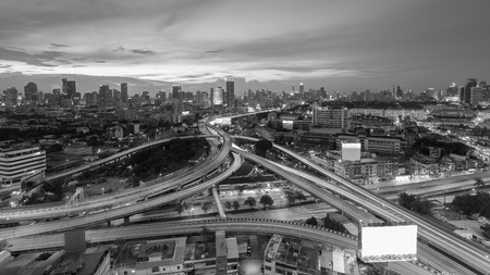 interchanged: Black and White, Highway interchanged with city business downtown background