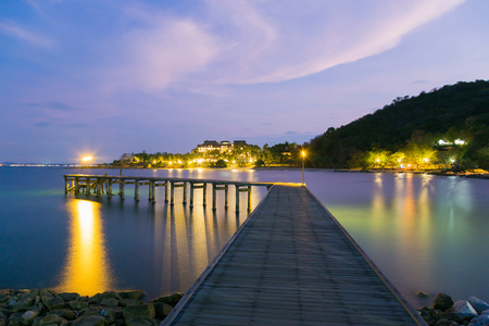 hatteras: Wooden walking path leading to the ocean skyline with mountain background night view Stock Photo