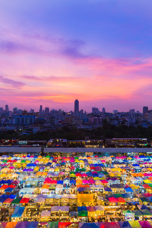 Aerial view, Bangkok night market with dramatic sky background, Thailand Stock Photo