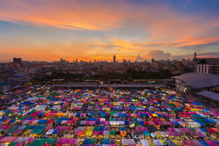 Top view multiple colours weekend market roof top with beautiful sunset sky background