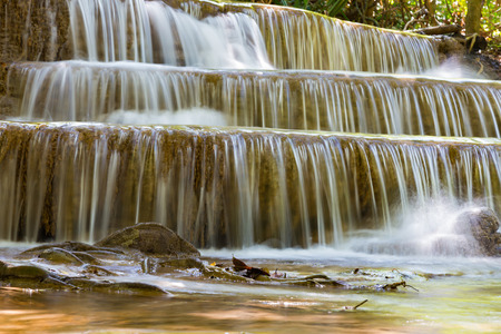 Waterfall in natural tropical deep forest national park of Thailand