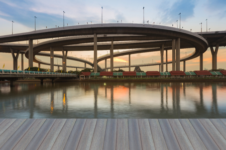 interchanged: Opening wooden floor, Highway interchanged river front with sunset sky background