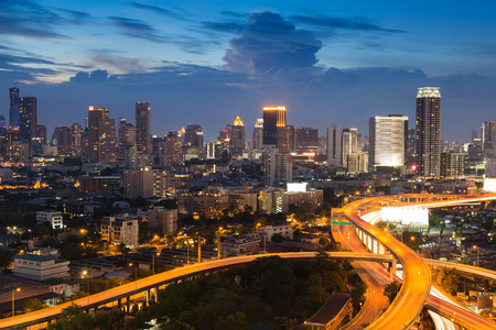 interchanged: Twilight, aerial view city downtown background with interchanged highway Stock Photo