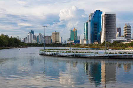 benjakitti: Office building with reflection in public park, Bangkok Thailand Stock Photo