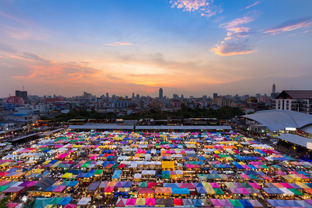 Multiple colours weekend market top view with beautiful sunset sky background Stock Photo