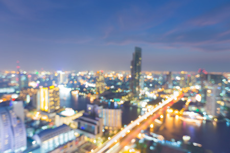 source of light: Blurred bokeh lights city building, abstract background night view Stock Photo