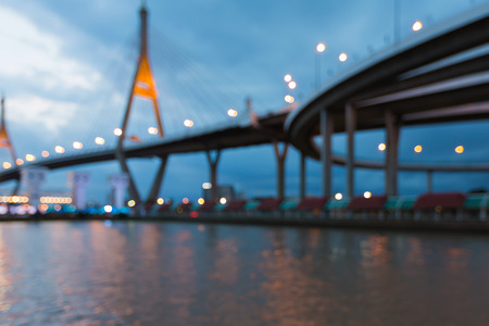 bridged: Blurred lights over suspension bridged waterfront, abstract background