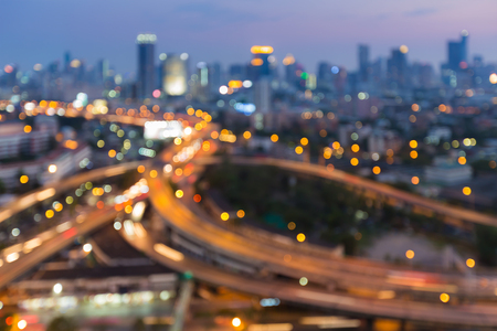 Abstract background, blurred bokeh lights highway interchanged and city downtown night view Stock Photo