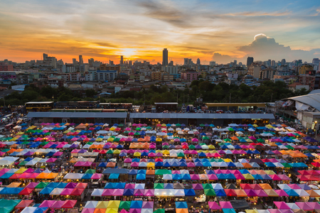 Aerial view Bangkok city night market with city downtown and beautiful sunset sky background Stock Photo