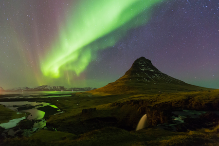northern light: Northern light over Kirkjufell volcano with fully stars on the sky, night view, natural landscape background
