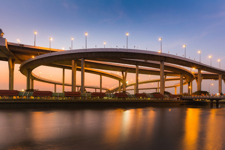 Highway interchanged riverfront with clear sunset sky background Stock Photo