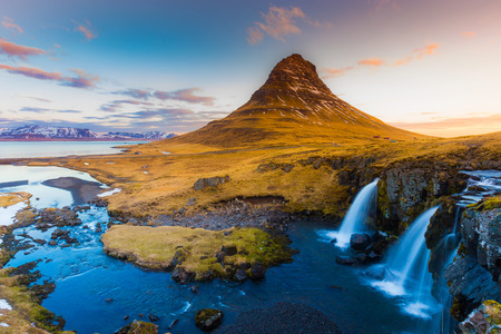 seson: Kirkjufell Volcano Mountain with waterfalls in late winter, Iceland winter seson natural landscape Stock Photo