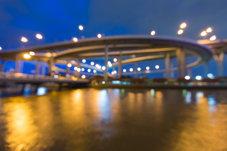 Abstract blurred light round highway interchanged river front Stock Photo