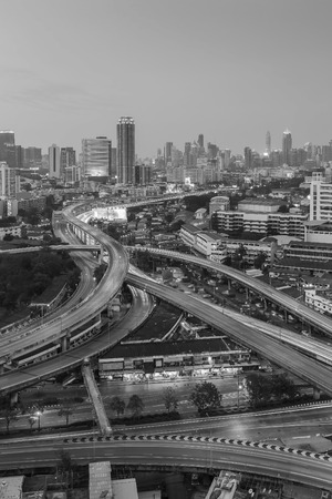 interchanged: Black and White, Aerial view twilight sky over city downtown background, highway interchanged, long exposure