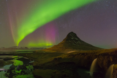 northern light: Northern Light over Kirkjufell volcano with fully of star on the sky, winter season in Iceland Stock Photo