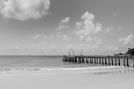 hatteras: Black and White, Natural beach with fishing pier leading to the sea