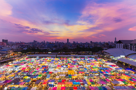 Aerial view Bangkok city night market with beauty after sunset sky background