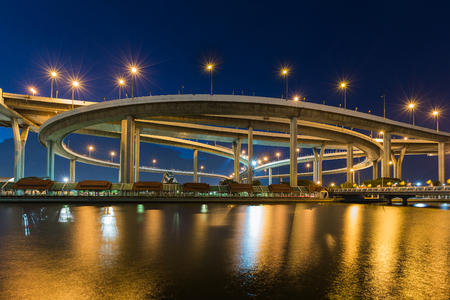 Twilight round highway interchanged river front, transportation background