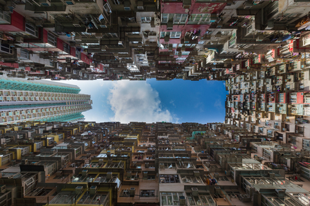 overpopulated: Overcrowded apartment residential building in Hong Kong city downtown Stock Photo