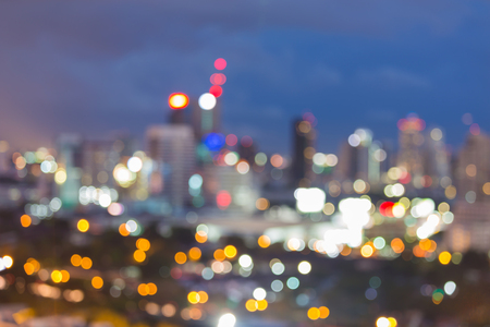 source of light: Night blurred lights colourful city downtown, abstract background