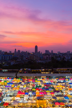 Multiple colour city night market with dramatic after sunset sky background