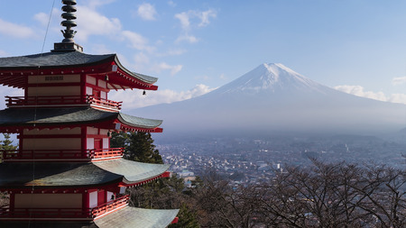 Fuji mountain behind red pagoda temple, winter season in Japan Editorial