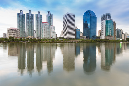 corporate building: Office building with water reflection in public park, Bangkok Thailand Stock Photo