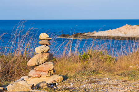 Stack stone on the seacoast with clear skyline background