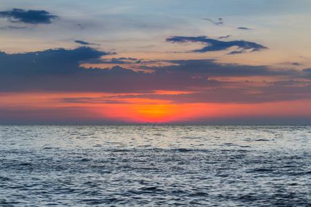 Sunset over the seacoast skyline, natural landscape background