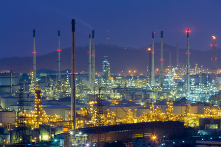 Night light over Oil refinery aerial view with twilight sky background