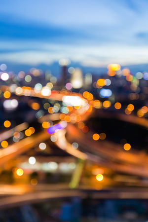 Blurred light highway overpass interchanged with twilight sky background Stock Photo